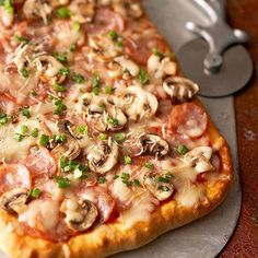 A healthy pizza recipe topped with savory Canadian bacon, fresh mushrooms, and gooey mozzarella? You bet! Enjoy for just 270 calories a slice./