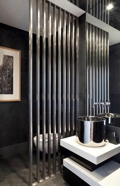 Powder Room - Epic impact design & cleverly chosen elements & decor. The wall divider makes a statement - gorgeous!