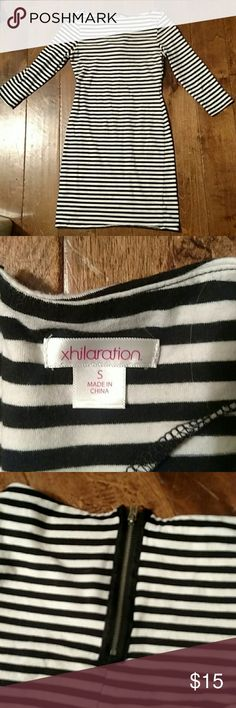 Black and white stripped dress Is knee length, stretchy, zipper in back, 3/4 sleeves. Xhilaration Dresses Long Sleeve