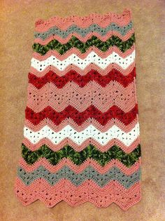Ravelry: 6-Day Kid Blanket pattern by Beth Elliott Horrible choice of colors but pinning because I love the granny and regular chevron patterning together. Pattern: http://www.ravelry.com/patterns/library/6-day-kid-blanket