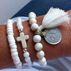this listing is for 1 beachcomber gypsy mermaid tassel bracelet white howlite beads, ancient middle eastern coin charm, with a white tassel.