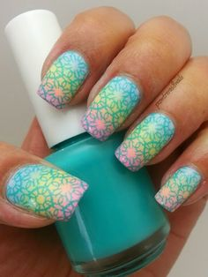 #Spring nails: I started with a base of two coats Kleancolor White and allowed it to fully dry. For the gradient I chose #Kleancolor pastel blue, pastel yellow and, pastel pink. I use a fluffy kitchen sponge for the gradient. I applied the gradient onto each nail 3 times. I applied top coat to smooth out the surface. The stamping plates I used was Cheeky princess charming jumbo plate 8. I stamped using Mundo de Uñas #24 Turquoise.