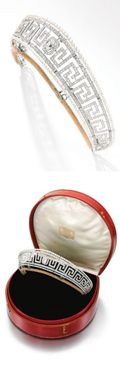 Important seed pearl and diamond tiara, Cartier, circa 1909 Designed as an open work Greek key band millegrain-set with circular-cut diamonds within an outer border of seed pearls, framing a central detachable old mine-cut diamond, inner circumference approximately 305mm, unsigned, later tiara frame, case stamped Cartier.