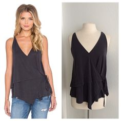 "Free People top NWT Free People tank top. Size S. 64% modal/ 36% polyester. Dark charcoal color. Super soft! Measures 30"" at longest point with a 38"" bust. Slightly oversized. Semi sheer. Reposh as it didn't fit the person I bought it for No trades. Poshmark onlyI am very open to fair offers! Free People Tops"