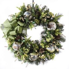 Decorated with a variety of holiday floral including pine, astilbe, berries, forest friends ornaments and a burlap bow.. Great for the front door or over a mantel.