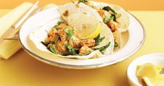 Serve Indian-style chicken and spinach on flour tortillas for dinner tonight and everyone will be asking for more!
