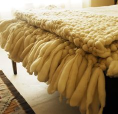 This gorgeous 'Clouds' large chunky knit blanket is a super chic master piece. Volumes of chunky superfine merino wool yarn have been loosely hand knitted together into big chunky knots that resemble small fluffy clouds. Finished with giant hand knotted fringes - this really is a forever piece finished to ensure the highest quality, softness and comfort.  This finished 'Clouds Throw' is the squishiest, most comfy blanket you've ever seen! It ideal for home décor, being able to be u...