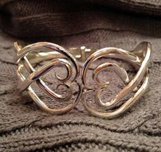 A personal favorite from my Etsy shop https://www.etsy.com/listing/127157530/double-fork-cuff-bracelet-double-heart