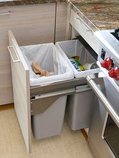 Pull out trash can and recycling bin. Never have an ugly trash can in your kitchen again. From Better Homes & Gardens.