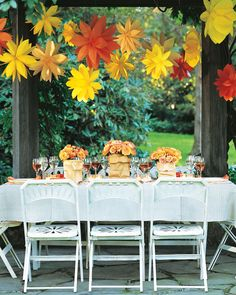Look at colorful paper bags in a new light: When folded and snipped, they make delightful hanging decorations. You'll need 6 gusseted bags (same size and color) for each flower.