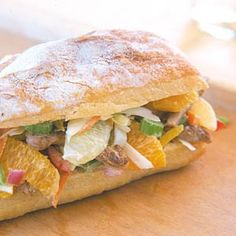 Pork, vegetables, and slaw mix make up this filling dinner sandwich.