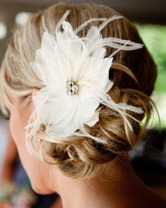 This bride's feather-and-rhinestone hairpiece was made with love by a close friend.