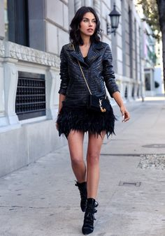 studded leather jacket with fur skirt and edgy boots