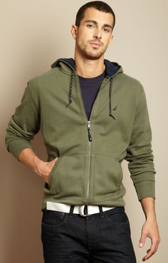 Easy going Green zip front sweatshirt with white belt, dark colored jeans. Nice