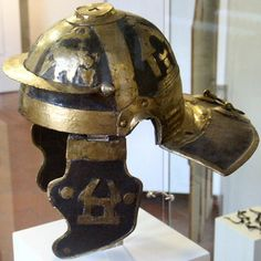 Roman legionary helmet with brass applique. Mid-I century AD.