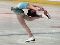 stretches for a lay back spin in ice skating | Caroline Zhang gets into a remarkable spin position.