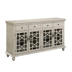 Display heirloom serveware and stow spare table linens in the dining room with this elegant sideboard, showcasing lattice-overlaid glass doors and a rubbe...