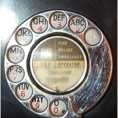 Rotary dial telephone. yup we had a yellow phone with the longest cord!
