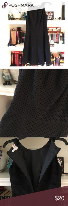 Size 0 black eyelet dress New York & co size 0 black eyelet dress. A line skirt with super flattering fit. Dry cleaned only. Zipper up back. New York & Company Dresses Midi