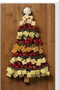 Christmas tree cheese tray with cherry tomatoes and rosemary