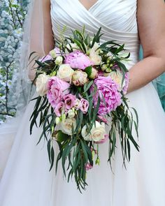 A lush wedding bouquet for a spring wedding, with peonies, eucalyptus and roses    #wedding #weddingbouquet #peonies