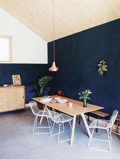 dining room with dark walls and plywood ceiling / sfgirlbybay