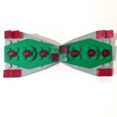 It is time to get your Shtick on and get some well deserved accolades for your unique style this holiday season.   No more fading into the crowd with this Blingy Christmas LEGO Bow Tie!  By featuring festive colors and an abundance of translucent accents, you are sure to light up a room.  Made with all LEGO brand pieces and  available in red as the dominant color or green as the dominant color.  You choose.   Quantities are limited.        LEGO® is a trademark of the LEGO® Group. This site ... Lego Jewelry, Brick Art, Lego Christmas, All Lego, Lego Group, Lego Brick, Business Card Holders, Abundance, Light Up