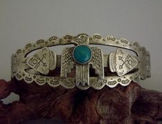 "Vintage ""Tourist Era"" Thunderbird Blue Green Turquoise Heavily Stamped Cuff Bracelet, Identifying  stamp says ""Turquoise."""