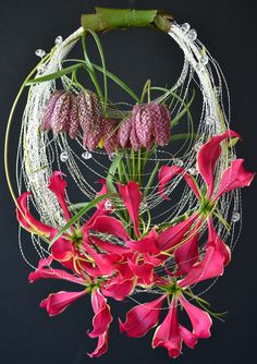 """Very usual shape! Needs more colour of course! love the leaf-wrapped """"handle"""" detail. """"purse"""" style circle bouquet of frittilaria and gloriosa lilies. Floral Bouquets, Wedding Bouquets, Wedding Flowers, Ikebana, My Flower, Flower Art, Floral Bags, Arte Floral, Flower Decorations"""
