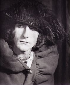 """Rrose Sélavy(1921)  Rrose Sélavy was one of the pseudonyms of artist Marcel Duchamp. The name, a pun, sounds like the French phrase """"Eros, c'est la vie"""", which translates to English as """"eros, that's life"""". It has also been read as """"arroser la vie"""" (""""to make a toast to life""""). Sélavy emerged in 1921 in a series of photographs by Man Ray of Duchamp dressed as a woman. Through the 1920s, Man Ray and Duchamp collaborated on more photos of Sélavy."""