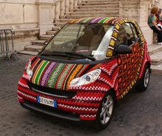 Crochet car love. Evidently there is something called yarn bombing where signs, objects, statues, etc., are covered in knitting or crochet.  Will have to look into this more.  Here is a car!