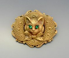 A bronze tone & paste cat brooch by Joseff of Hollywood, 1960-70's