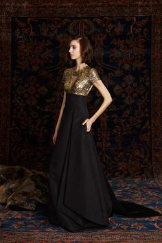 Pamella Roland Pre-Fall 2016 - I think I will wear this dress a lot when I am queen. Gold bodice with v neckline and short sleeves, black pleated dramatic skirt