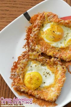 Cheesy Baked Egg Toast on a plate...sounds like breakfast for dinner to me - eggs on toast
