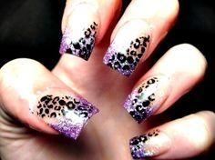 Glitterly purple tips with black leopard spots. Love fake nails! nail-art