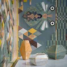 Nat(f)use - Vases in marble and Onyx, background inlaid marble and glass screen. Patricia Urquiola for Budri