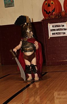 I love this King Leonidas from 300 toddler costume. hee hee abs!