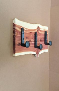 Live edge Wall Coat Rack with Railroad Spike Hooks.