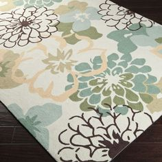 You'll appreciate the workmanship and attention to detail that goes into making this hand-hooked area rug. This rug has an all-over floral pattern in softly muted colors and is made from durable, long-wearing polyester for long life and beauty.