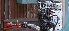 #usmilitary Robot Running Man from the Florida Institute for Human and Machine Cognition proceeds to turn a valve in the U.S. Defense Advanced Research Projects Agency Robotics Challenge in Pomona, Calif.
