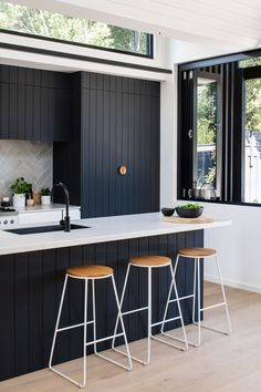 "The dark kitchen cabinetry is a nod to the exterior, ""as the pattern of the shiplapped cladding informed the grooves of the kitchen joinery,"" says the firm. Kitchen Pleated House by Megowan Architectural Home Decor Kitchen, Kitchen Interior, Kitchen Ideas, Kitchen Splashback Ideas, Black Kitchen Decor, Kitchen Yellow, Ikea Kitchen, Design Kitchen, Black Kitchens"