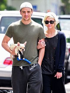Vincent Piazza does some light lifting for girlfriend Simpson carrying the star's new French bulldog puppy during a New York City stroll.