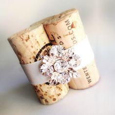 Glam Vineyard Wedding must-have! Gorgeous, sparkly flower-shaped gem set in rose-colored gold on vintage wine corks. High-quality, artisan Place Card Holder or wedding favor! http://karas-vineyard-wedding-2.myshopify.com/products/golden-flower-gemstone-wedding-place-card-holder