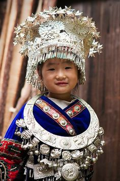 Little Miao girl in traditional costume