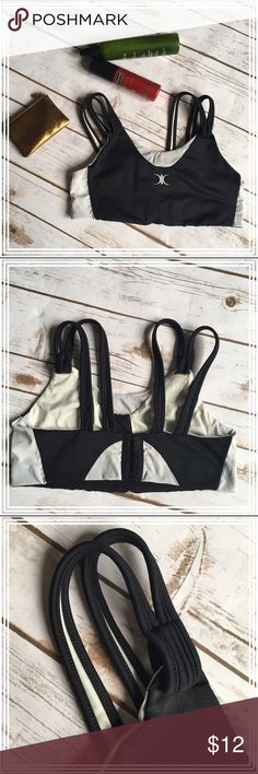 """Black and white lightweight sports bra Non-padded sports bra that keeps you secure as you work out, and prevents excessive movement/bounce. The 5-hook closure is super strong and keeps you """"all in"""" throughout your workout. Medium to light support, great for strength training. The itchy size tag is removed but it will best fit a size 34-36 bra size and up to a D cup. On the tightest hook and laying flat, the band measures 26"""" around (a lot of stretch). On the loosest hook and laying flat, the…"""