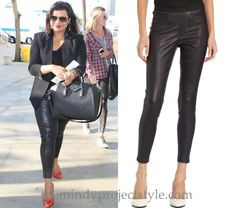Mindy Kaling wears seamed leather leggings with a black blazer, Givenchy bag and printed pumps!