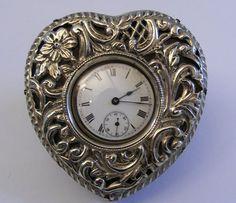 A Victorian heart shaped silver boudoir clock, Birmingham 1898
