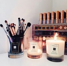 Joe Malone candles as makeup brush holders