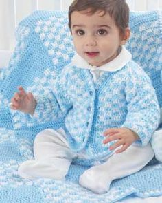 Checks and solid blocks alternate in this visually simulating and cute blankie. Shown in Bernat Softee Baby.