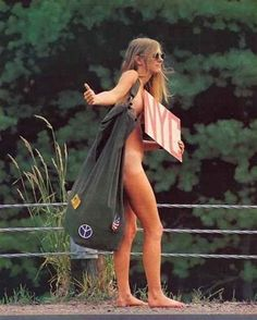 A woman hitchhiking back to New York after a festival in 1969.